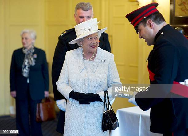 Queen Elizabeth II visits the Company of Pikemen and Musketeers at HAC Armoury House on May 12 2010 in London England