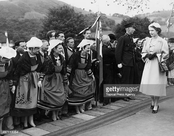 Queen Elizabeth II visits the International Musical Eisteddfod at Llangollen in Wales UK 11th July 1953 A group of women in traditional costumes from...