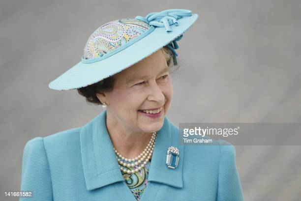Queen Elizabeth II visits the Isle of Man, 8th August 1989. She is wearing a hat by Philip Somerville and an aquamarine brooch.