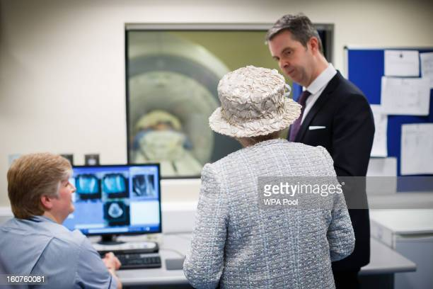 Queen Elizabeth II visits the MRI control room with Dr Dan Rose as she opens the new MRI unit at The Queen Elizabeth Hospital on February 5 2013 in...
