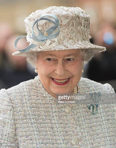 Queen Elizabeth II visits the new Barnardo's HQ in Barkingside on December 10 2013 in London England