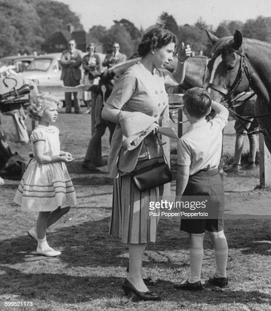 Queen Elizabeth II visits the polo ponies with Princess Anne and Prince Charles after watching the Duke of Edinburgh play polo for the Household...