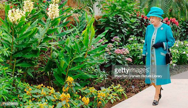 Queen Elizabeth II visits the Royal Horticultural Society Garden at Wisley, Surrey where she officially opened The Glasshouse in celebration of the...