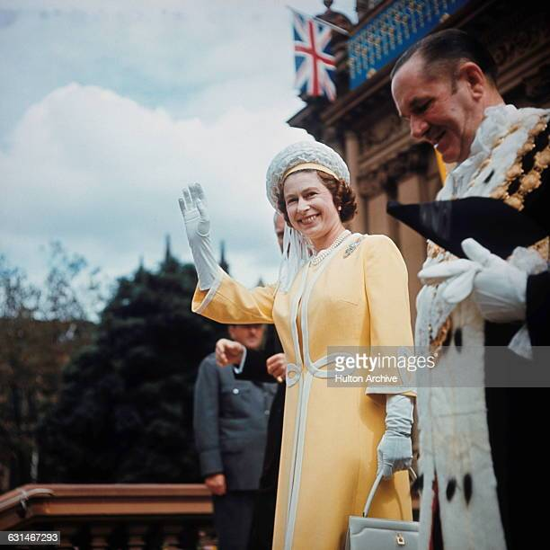 Queen Elizabeth II visits the Town Hall in Sydney with Emmet McDermott , Lord Mayor of Sydney, during her tour of Australia, May 1970. She is there...