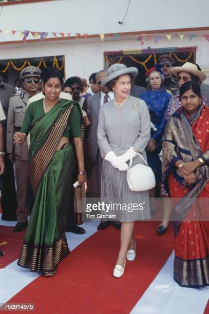 Queen Elizabeth II visits the village of Devara Yamzal near Hyderabad during a nineday State Visit to India November 1983 The Queen is wearing a hat...