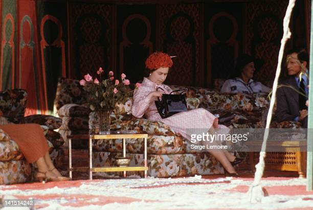Queen Elizabeth II waits for King Hassan in Marrakech during her state visit to Morocco, 27th October 1980.