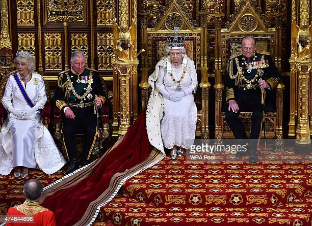 Queen Elizabeth II waits to give the Queen's Speech from the throne in the House of Lords next to Prince Philip Duke of Edinburgh and Prince Charles...