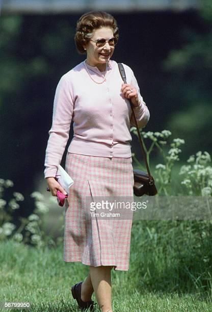 Queen Elizabeth II walking in the grounds of Windsor Castle.