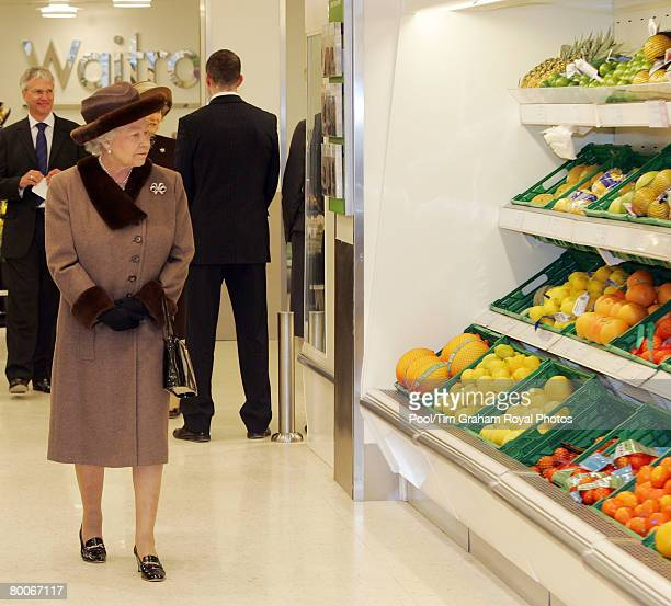 Queen Elizabeth II walks around a Waitrose supermarket during a tour of the redeveloped King Edward Court Shopping Centre on February 29 2008 in...