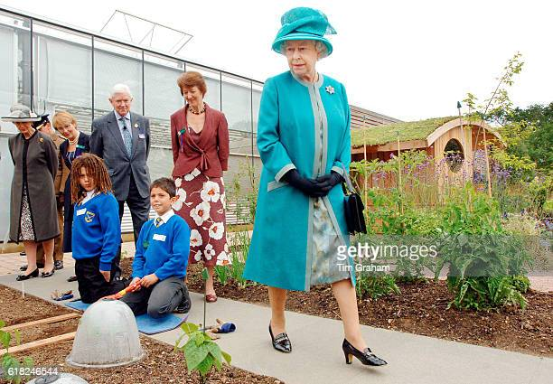 Queen Elizabeth II walks around the new Clore Learning Centre and Teaching Garden during her visit to the Royal Horticultural Society Garden at...