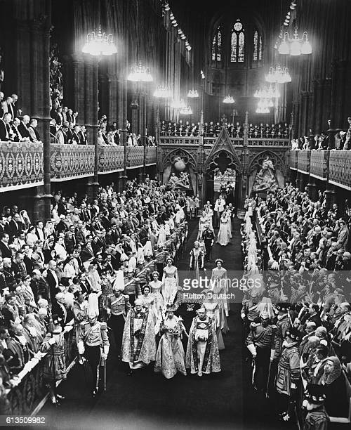 Queen Elizabeth II walks down the nave in Westminster Abbey after being crowned during her Coronation ceremony.