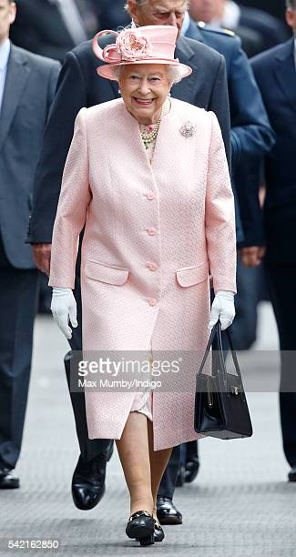 Queen Elizabeth II walks down the platform of Liverpool Lime railway station after disembarking the Royal Train on June 22 2016 in Liverpool England