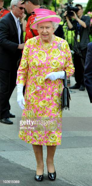 Queen Elizabeth II walks out of Government House to unveil a statue of herself on July 3 2010 in Winnipeg Canada The Queen and Duke of Edinburgh are...