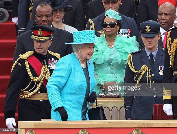 Queen Elizabeth II walks past King Mswati III of Swaziland and Inkhosikati LaMbikiza of Swaziland as she attends the Armed Forces Parade and Muster...