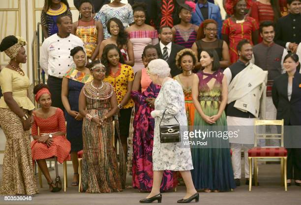 Queen Elizabeth II walks past some of the Young Leaders after posing for a group photo at the 2017 Queen's Young Leaders Awards Ceremony at...