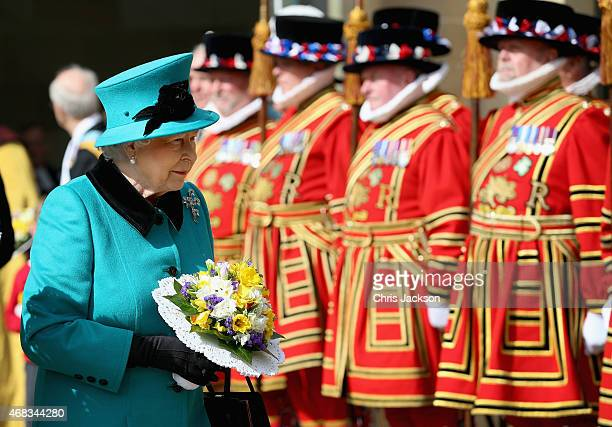 Queen Elizabeth II walks past Yeomen as she leaves Sheffield Cathedral after the traditional Royal Maundy Service at Sheffield Cathedral on April 2...