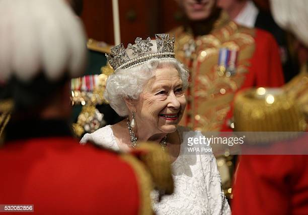 Queen Elizabeth II walks through Norman Porch ahead of the State Opening of Parliament in the House of Lords at the Palace of Westminster on May 18...