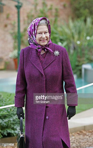Queen Elizabeth II walks through one of the gardens on the press and VIP day at Chelsea Flower Show on May 22 2006 in London England