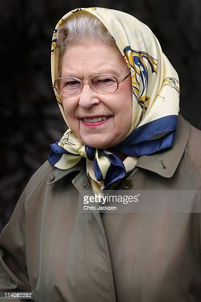 Queen Elizabeth II walks through the grounds of Windsor Castle during Windsor Horse Show on May 11 2011 in Windsor England
