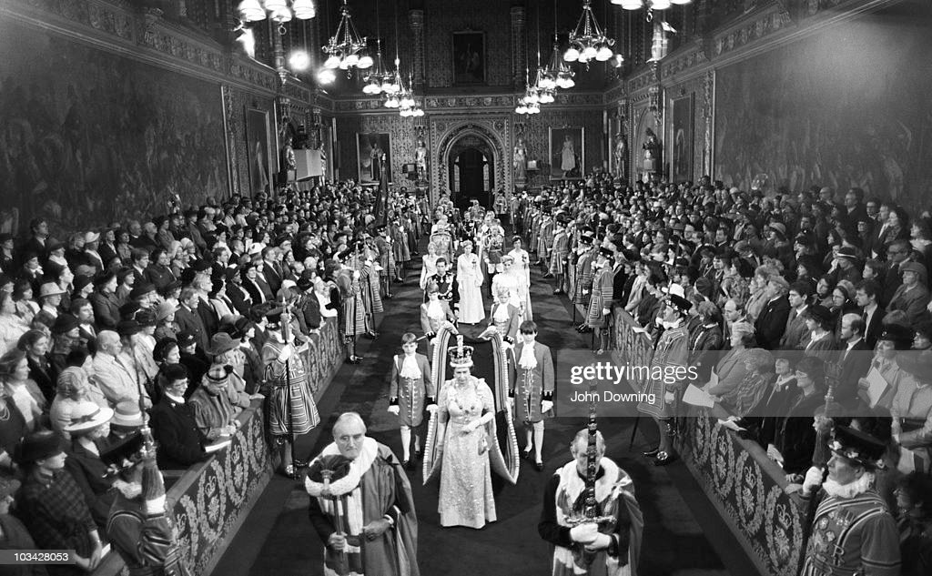 Queen Elizabeth II walks through the Royal Gallery in the Palace of Westminster during the State Opening of Parliament on November 06, 1984.