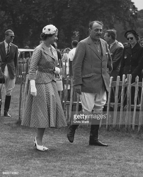 Queen Elizabeth II walks to the Royal Enclosure during the Coronation Cup match between England and Argentina at Cowdray Park UK accompanied by...