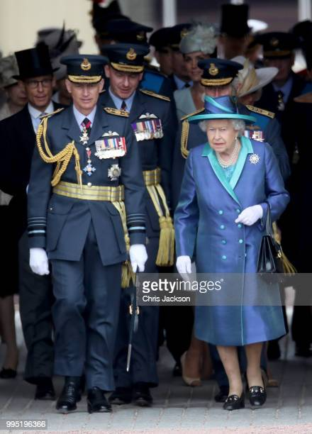Queen Elizabeth II walks with Air Chief Marshal Sir Stephen Hillier at the RAF 100 ceremony as members of the Royal Family attend events to mark the...