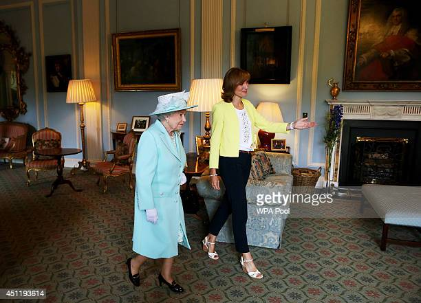 Queen Elizabeth II walks with Antiques Roadshow presenter Fiona Bruce at Hillsborough Castle during filming of the show on the third and final day of...