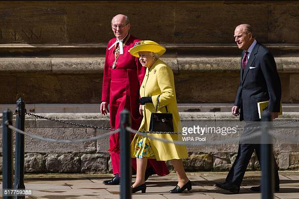 Queen Elizabeth II walks with Dean of Windsor David Conner followed by Prince Philip Duke of Edinburgh as they leave after the Easter Sunday church...