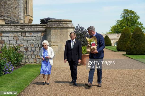 Queen Elizabeth II walks with RHS President Keith Weed towards a border in the gardens of Windsor Castle, to watch the plating of the Duke of...