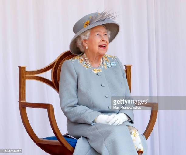 Queen Elizabeth II watches a flypast by the RAF Red Arrows as she attends a military parade, held by the Household Division in the Quadrangle of...