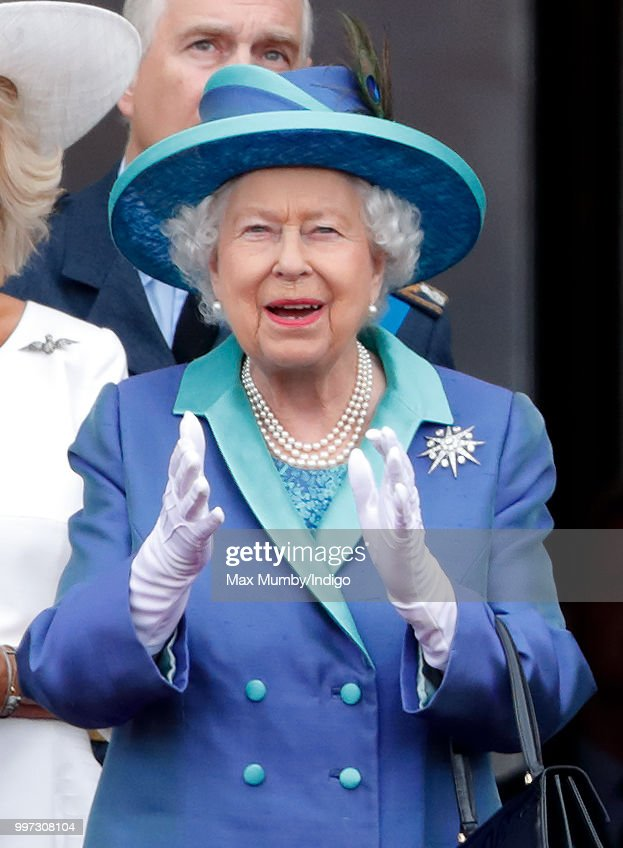 Queen Elizabeth II watches a flypast to mark the centenary of the Royal Air Force from the balcony of Buckingham Palace on July 10, 2018 in London, England. The 100th birthday of the RAF, which was founded on on 1 April 1918, was marked with a centenary parade with the presentation of a new Queen's Colour and flypast of 100 aircraft over Buckingham Palace.