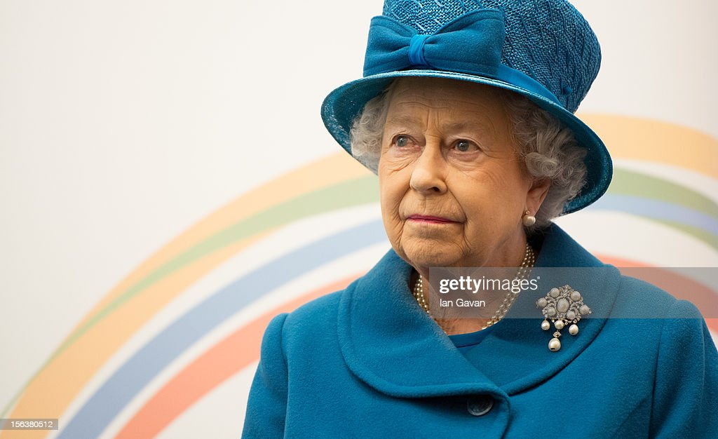 Queen Elizabeth II watches a presentation during her visit to the Royal Commonwealth Society on November 14, 2012 in London, England.