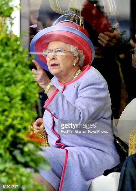Queen Elizabeth II watches an RAF flypast after presenting new Colours at RAF Fairford at the opening of the Royal International Air Tattoo on July...