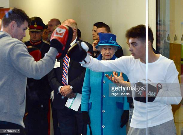Queen Elizabeth II watches boxing training during a visit to The Factory Youth Zone on November 14 2013 in Manchester England