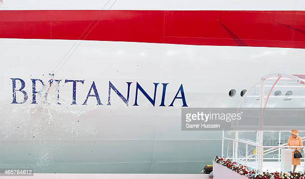 Queen Elizabeth II watches champagne smash on the hull of Britannia as she attends the naming ceremony for the PO Cruises vessel at Ocean Cruise...