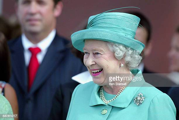 Queen Elizabeth II watches during Cartier International Day at Guards Polo Club, Windsor Great Park on July 24, 2005 in Windsor, England.