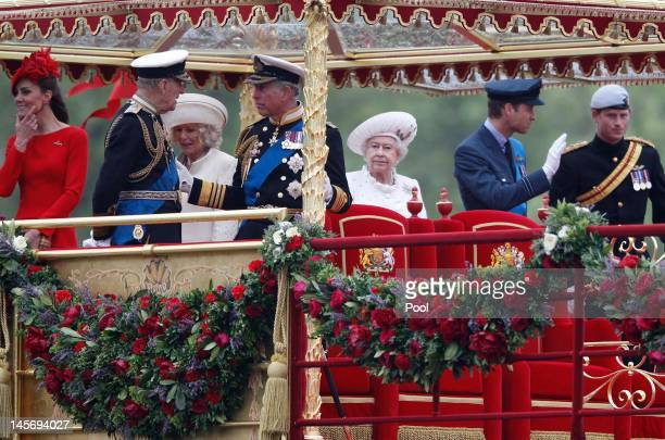 Queen Elizabeth II watches from onboard the Spirit of Chartwell with other members of the Royal family during during the Diamond Jubilee Thames River...