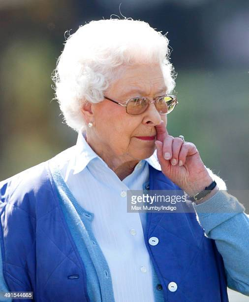 Queen Elizabeth II watches her horse 'Balmoral Gemini' compete in the Highland class on day 3 of the Royal Windsor Horse Show at Home Park on May 16...
