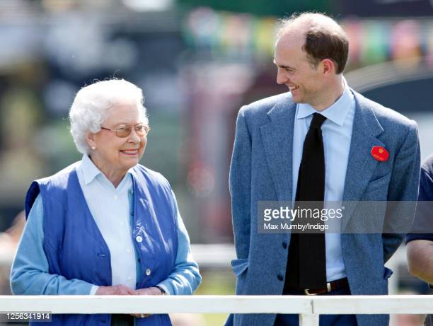 Queen Elizabeth II watches her horse 'Barber's Shop' compete in the Tattersalls and Ror Thoroughbred Ridden Show Class on day 3 of the Royal Windsor...