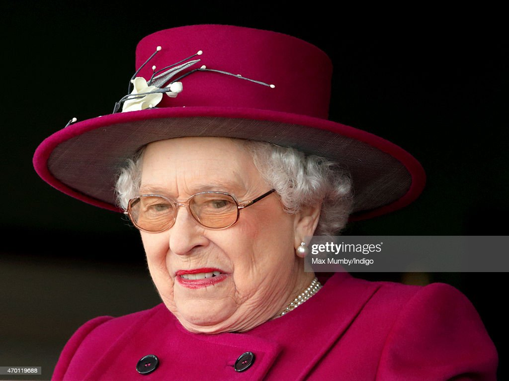Queen Elizabeth II watches her horse 'Capel Path' run in the Dubai Duty Free Full of Surprises Handicap Stakes during the Dubai Duty Free Spring Trials Meeting at Newbury Racecourse on April 17, 2015 in Newbury, England.