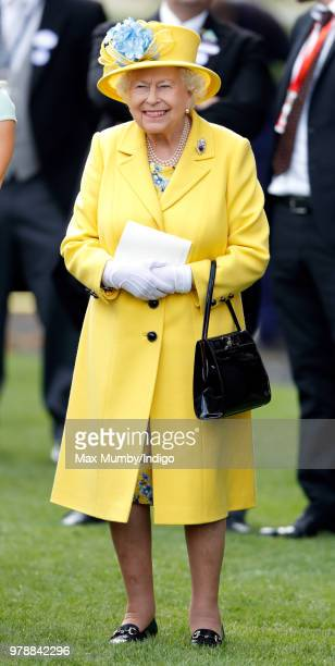 Queen Elizabeth II watches her horse 'Fabricate' run in the Wolferton Stakes on day 1 of Royal Ascot at Ascot Racecourse on June 19, 2018 in Ascot,...