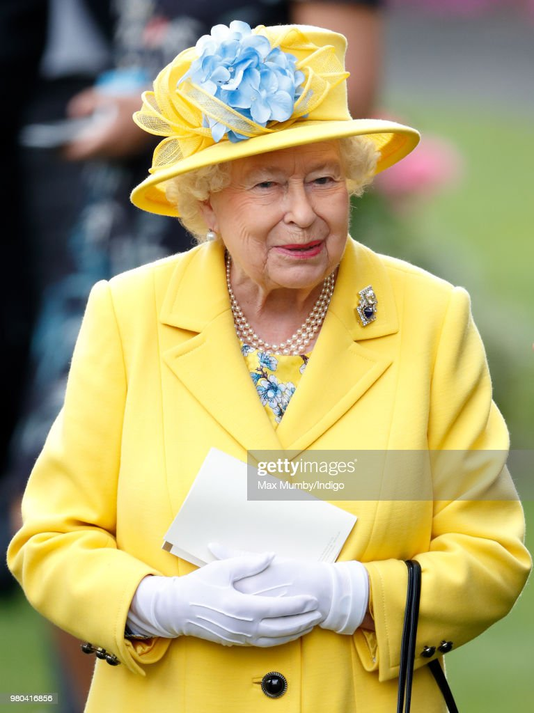 Queen Elizabeth II watches her horse 'Fabricate' run in the Wolferton Stakes on day 1 of Royal Ascot at Ascot Racecourse on June 19, 2018 in Ascot, England.