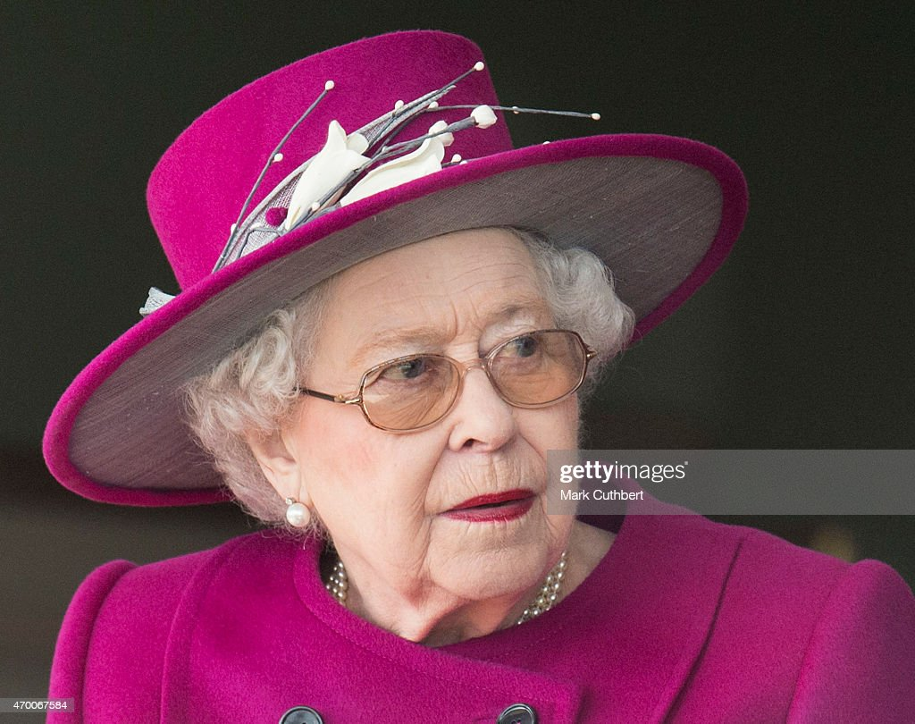 Queen Elizabeth II watches her horse 'Ring of Truth' in Race 2 at the Dubai Duty Free Spring Trials Meeting at Newbury Racecourse on April 17, 2015 in Newbury, England.