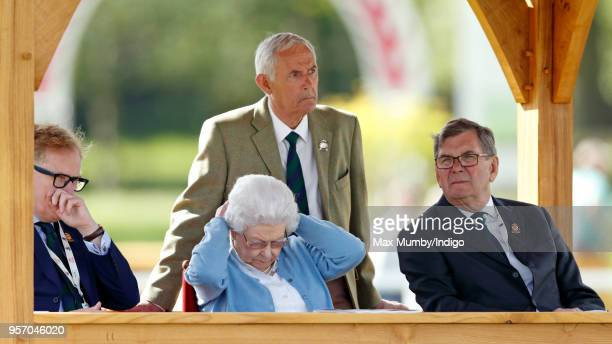 Queen Elizabeth II watches her horse 'Sparkler' compete in the Flat Ridden Sport Horse class on day 1 of the Royal Windsor Horse Show in Home Park on...