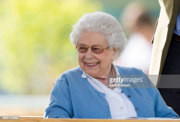 Queen Elizabeth II watches her horse Sparkler in the Flat Ridden Sport Horse event on the first day of The Royal Windsor Horse show at Home Park on...