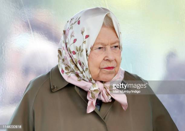 Queen Elizabeth II watches her horses 'Balmoral Gemini' and 'Bybeck Nightingale' compete in the Highland Pony and Fell Pony classes on day 3 of the...