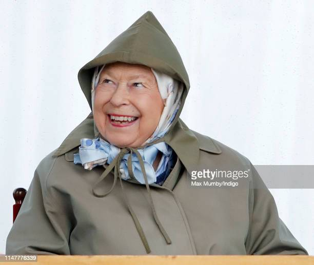 Queen Elizabeth II watches her hoses 'Lancer IV' & 'Tower Bridge' compete in the Four Year Old Hunter & Heavyweight Hunter classes as she attends day...