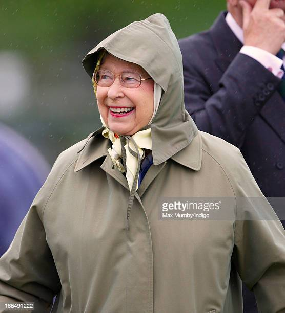 Queen Elizabeth II watches one of her horses compete in the Highland class on day 3 of the Royal Windsor Horse Show on May 10 2013 in Windsor England