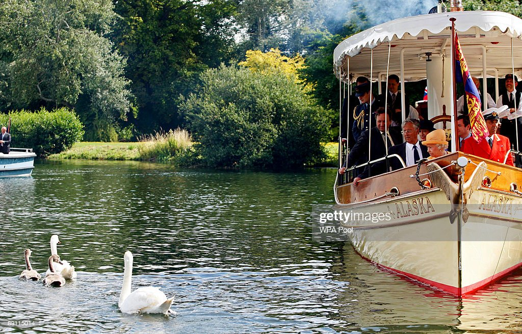 Queen Elizabeth II (front) watches swans swim away from the steam launch 'Alaska' during a swan upping census on the River Thames on July 20, 2009 near Windsor, England. During the ancient annual ceremony the Swan Marker leads a team of Swan Uppers on a five-day journey along the River Thames from Sunbury-on-Thames through Windsor to Abingdon counting, marking and checking the health of all unmarked swans.