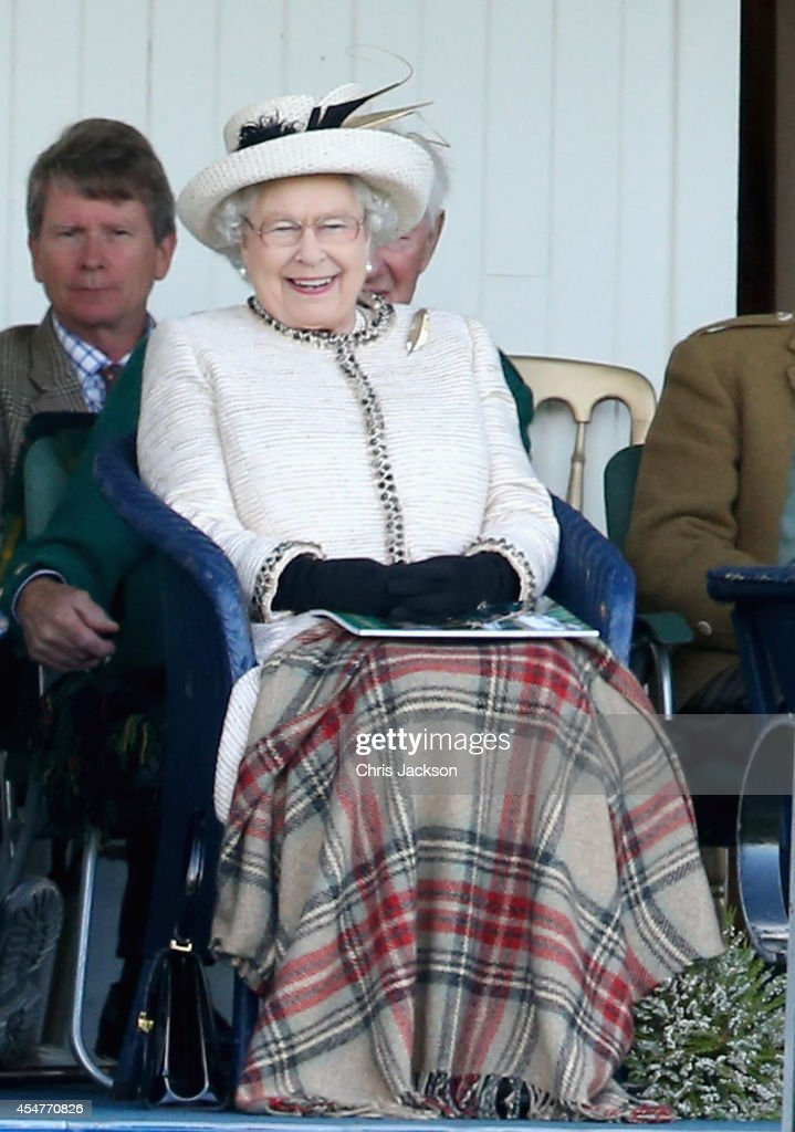 Queen Elizabeth II watches the action during the Braemar Highland Games on September 6, 2014 in Braemar, Scotland. The Braemar Gathering is the most famous of the Highland Games and is known worldwide. Each year thousands of visitors descend on this small Scottish village on the first Saturday in September to watch one of the more colourful Scottish traditions. The Gathering has a long history and in its modern form it stretches back nearly 200 years